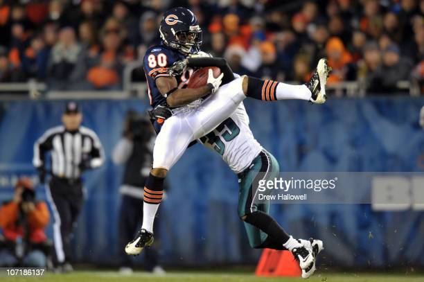Wide receiver Earl Bennett of the Chicago Bears catches a pass in front of cornerback Trevard Lindley of the Chicago Bears at Soldier Field on...