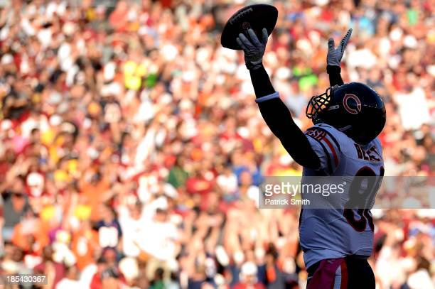 Wide receiver Earl Bennett of the Chicago Bears celebrates a touchdown that was then negated after a penalty against the Washington Redskins at...