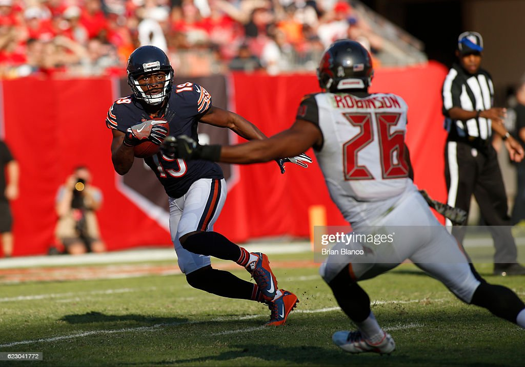 Wide receiver Eddie Royal #19 of the Chicago Bears looks for room to run around defensive back Josh Robinson #26 of the Tampa Bay Buccaneers during a punt return in the third quarter of an NFL game on November 13, 2016 at Raymond James Stadium in Tampa, Florida.
