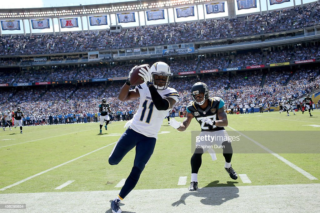 Wide receiver Eddie Royal #11 of the San Diego Chargers goes out of bounds after making a catch against corner back Dwayne Gratz #27 of the Jacksonville Jaguars at Qualcomm Stadium on September 28, 2014 in San Diego, California.