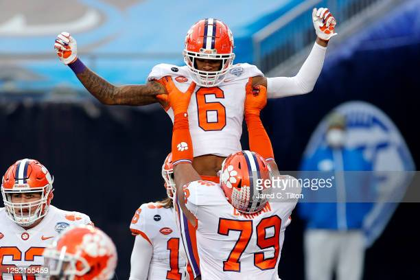 Wide receiver E.J. Williams of the Clemson Tigers celebrates with teammates after scoring a second quarter touchdown against the Notre Dame Fighting...