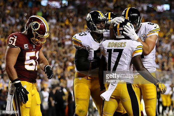 Wide receiver Eli Rogers of the Pittsburgh Steelers celebrates with teammates tight end Jesse James and center Maurkice Pouncey after scoring a...