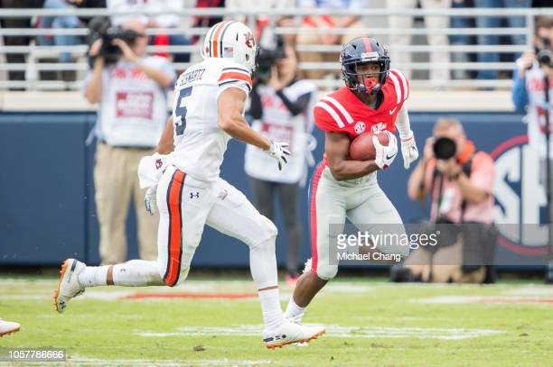 Wide receiver Elijah Moore of the Mississippi Rebels looks to run the ball by defensive lineman Derrick Brown of the Auburn Tigers at VaughtHemingway...