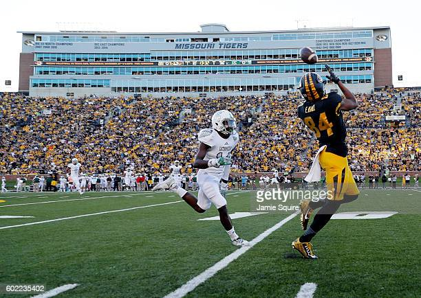 Wide receiver Emanuel Hall of the Missouri Tigers catches a pass and beats defensive back Ross Williams of the Eastern Michigan Eagles in for a...