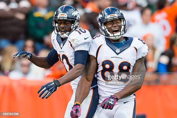 Wide receiver Emmanuel Sanders celebrates with wide receiver Demaryius Thomas of the Denver Broncos after Sanders scored during the second half...
