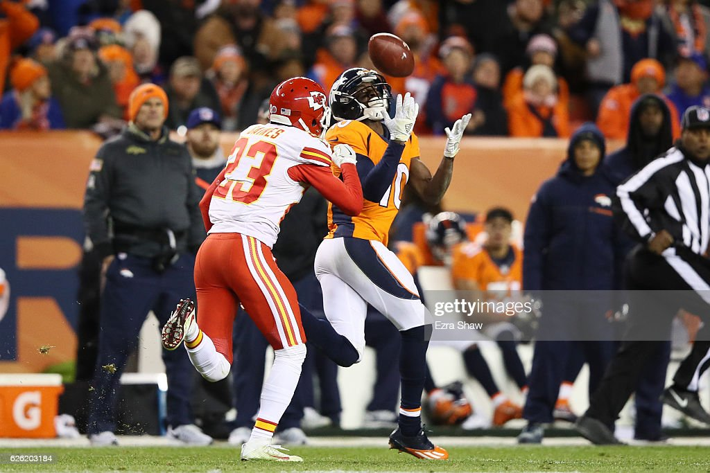 Wide receiver Emmanuel Sanders #10 of the Denver Broncos catches a pass while defended by cornerback Phillip Gaines #23 of the Kansas City Chiefs in the fourth quarter of the game at Sports Authority Field at Mile High on November 28, 2016 in Denver, Colorado.