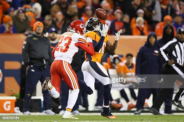 Wide receiver Emmanuel Sanders of the Denver Broncos catches a pass while defended by cornerback Phillip Gaines of the Kansas City Chiefs in the...