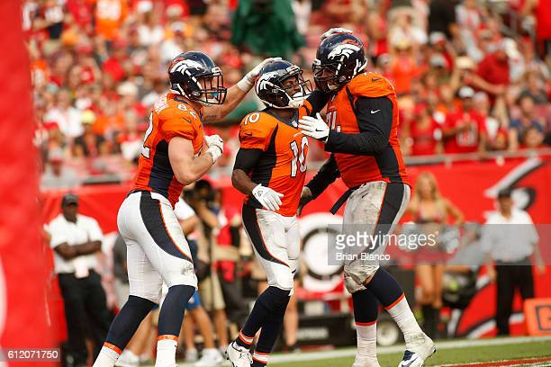 Wide receiver Emmanuel Sanders of the Denver Broncos celebrates his touchdown with teammates tight end Jeff Heuerman and offensive tackle Ty...