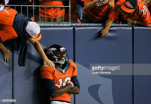 Wide receiver Emmanuel Sanders of the Denver Broncos celebrates with Denver Broncos fans after catching a pass for a 67yard touchdown against the...