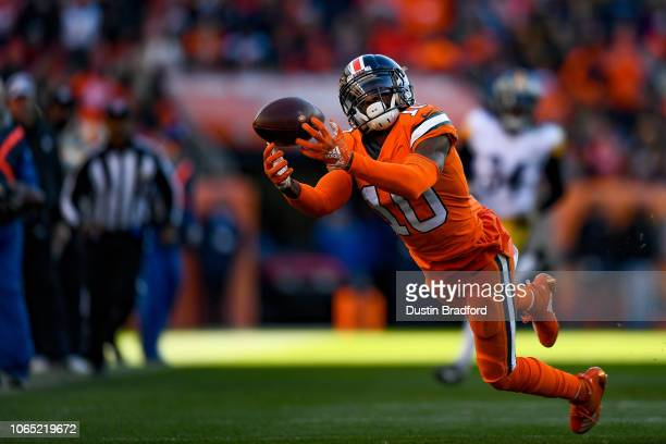 Wide receiver Emmanuel Sanders of the Denver Broncos dives for a ball on what would have been a long completion and first down against the Pittsburgh...