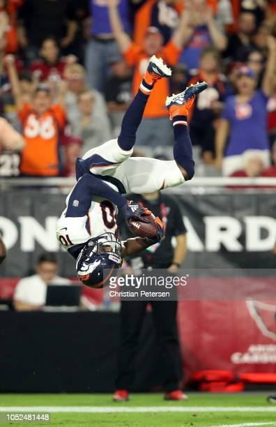 Wide receiver Emmanuel Sanders of the Denver Broncos flips in to the end zone after catching a 64yard pass during the second quarter against the...