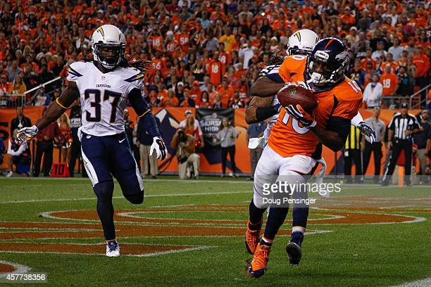 Wide receiver Emmanuel Sanders of the Denver Broncos has a 2yard second quarter touchdown catch as defensive back Jahleel Addae of the San Diego...