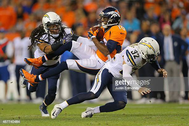Wide receiver Emmanuel Sanders of the Denver Broncos has a second quarter catch as cornerback Jason Verrett and free safety Eric Weddle of the San...