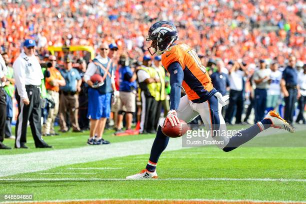 Wide receiver Emmanuel Sanders of the Denver Broncos has a six yard touchdown reception in the second quarter of a game against the Dallas Cowboys at...