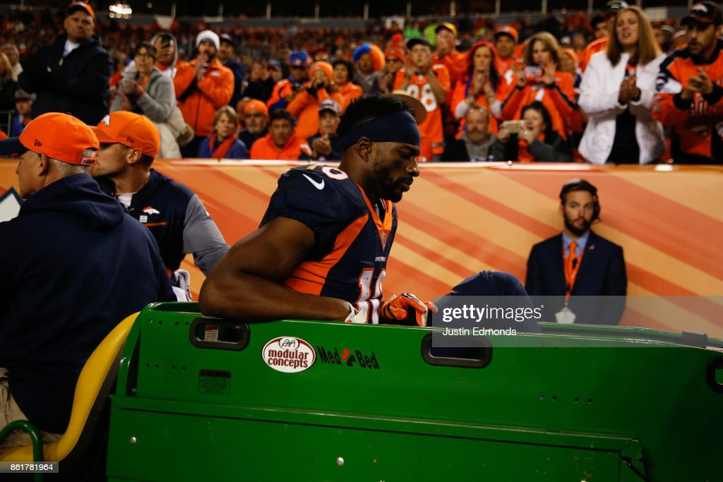 Wide receiver Emmanuel Sanders #10 of the Denver Broncos is carted off the field by the medical staff after injuring his right leg during the third quarter against the New York Giants at Sports Authority Field at Mile High on October 15, 2017 in Denver, Colorado. The Giants defeated the Broncos 23-10.
