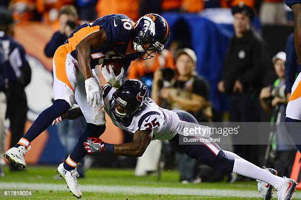 Wide receiver Emmanuel Sanders of the Denver Broncos is tackled after catching a pass by cornerback Kareem Jackson of the Houston Texans at the...