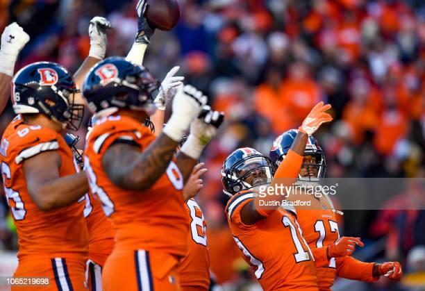 Wide receiver Emmanuel Sanders of the Denver Broncos leads a celebration in the end zone after a second quarter Denver Broncos touchdown catch by...