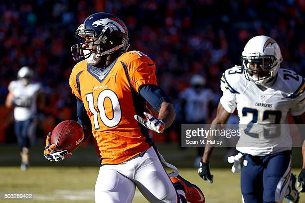 Wide receiver Emmanuel Sanders of the Denver Broncos looks for yardage after a catch on a play that would go for 46 yards before a Fumble by Sanders...