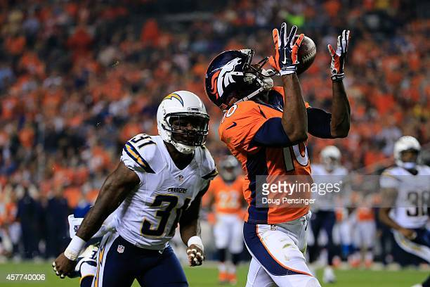 Wide receiver Emmanuel Sanders of the Denver Broncos makes a catch for a 31 yard second quarter touchdown ahead of cornerback Richard Marshall of the...