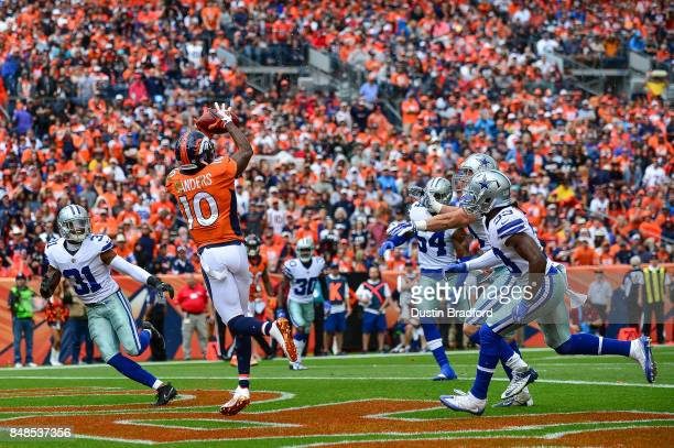 Wide receiver Emmanuel Sanders of the Denver Broncos makes a catch for a 10yard touchdown against the Dallas Cowboys in the first quarter of a game...