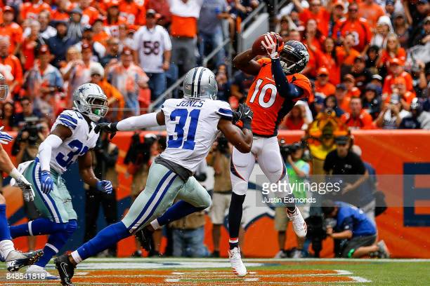 Wide receiver Emmanuel Sanders of the Denver Broncos makes a catch for a 10yard first quarter touchdown against the Dallas Cowboys at Sports...