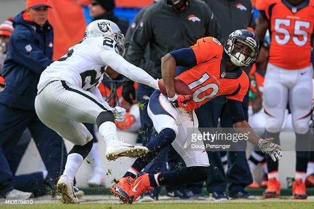 Wide receiver Emmanuel Sanders of the Denver Broncos makes a catch as cornerback D.J. Hayden of the Oakland Raiders forces him out of bounds during a...