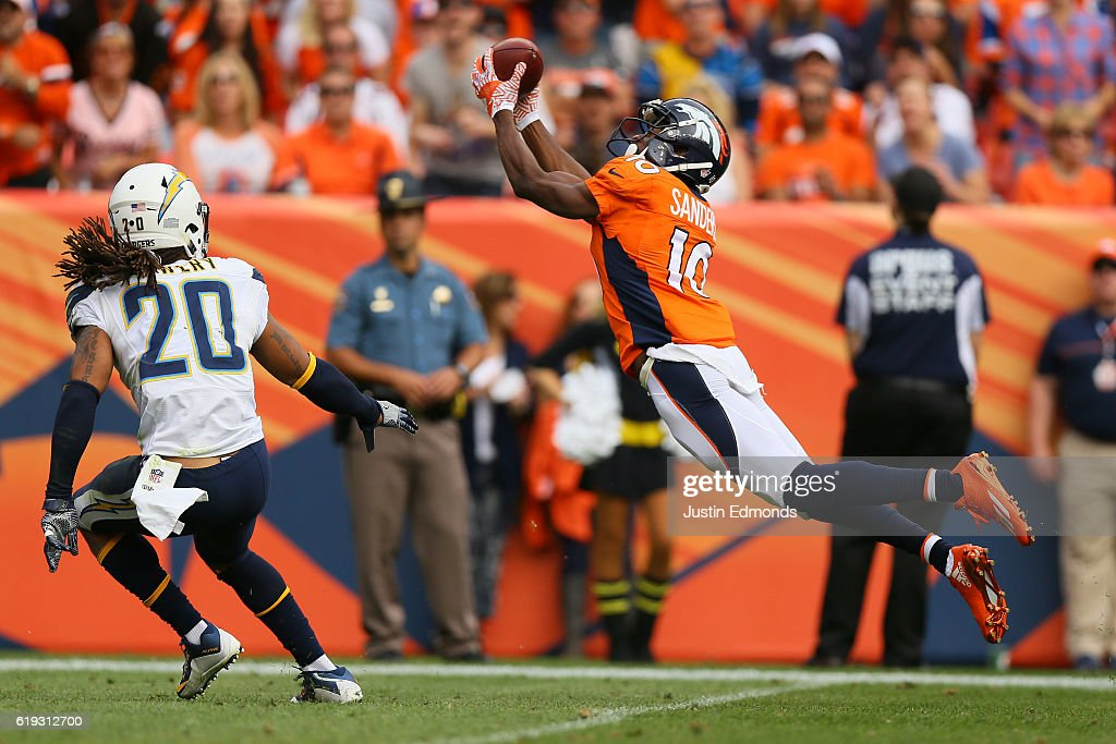 Wide receiver Emmanuel Sanders #10 of the Denver Broncos makes a diving catch in the second quarter of the game against the San Diego Chargers at Sports Authority Field at Mile High on October 30, 2016 in Denver, Colorado.
