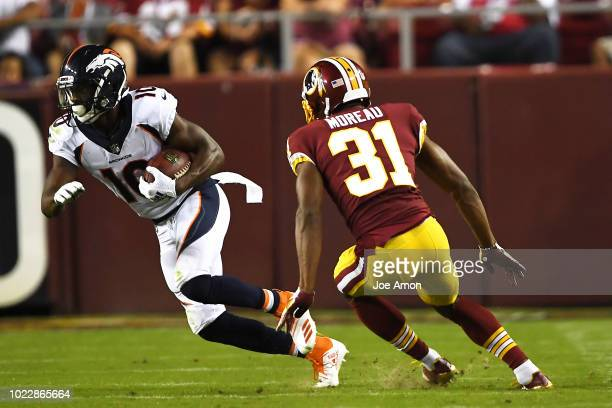 Wide receiver Emmanuel Sanders of the Denver Broncos pulls in a catch against cornerback Fabian Moreau of the Washington Redskins at FedExField...