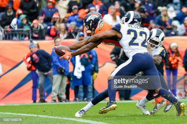 Wide receiver Emmanuel Sanders of the Denver Broncos reaches across the goal line for a thirdquarter touchdown as cornerback Marcus Peters of the Los...
