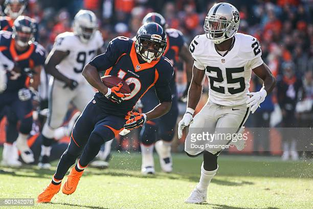 Wide receiver Emmanuel Sanders of the Denver Broncos runs for an 11-yard gain and is pursued by cornerback D.J. Hayden of the Oakland Raiders after a...