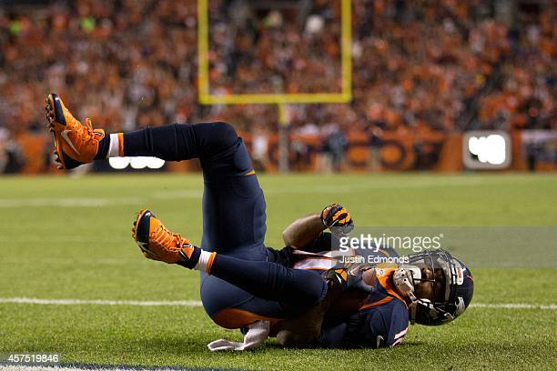 Wide receiver Emmanuel Sanders of the Denver Broncos scores on a 3yard touchdown pass in the first quarter of a game against the San Francisco 49ers...