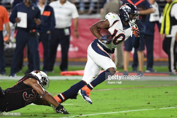 Wide receiver Emmanuel Sanders of the Denver Broncos slips past defensive back Rudy Ford of the Arizona Cardinals during the second quarter at State...