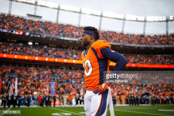 Wide receiver Emmanuel Sanders of the Denver Broncos stands on the sideline before a game against the Houston Texans at Broncos Stadium at Mile High...