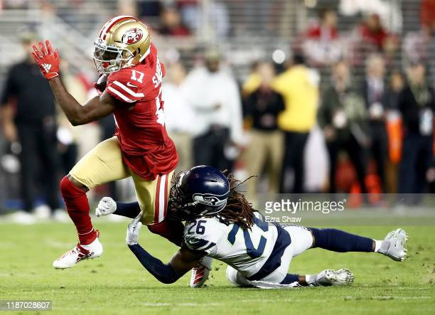 Wide receiver Emmanuel Sanders of the San Francisco carries the ball against the defense of cornerback Shaquill Griffin of the Seattle Seahawks at...