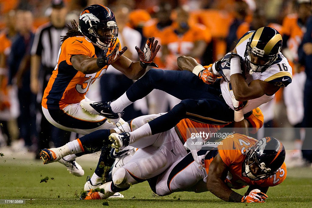 Wide receiver Emory Blake #16 of the St. Louis Rams gets hit by Linebacker Steven Johnson #53, Safety David Bruton #30 and Cornerback Quentin Jammer #23 of the Denver Broncos during a pre-season game at Sports Authority Field Field at Mile High on August 24, 2013 in Denver, Colorado. The Broncos defeated the Rams 27-26.