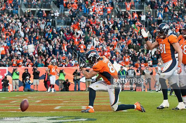 Wide receiver Eric Decker of the Denver Broncos celebrates a touchdown reception against the Cleveland Browns during a game at Sports Authority Field...