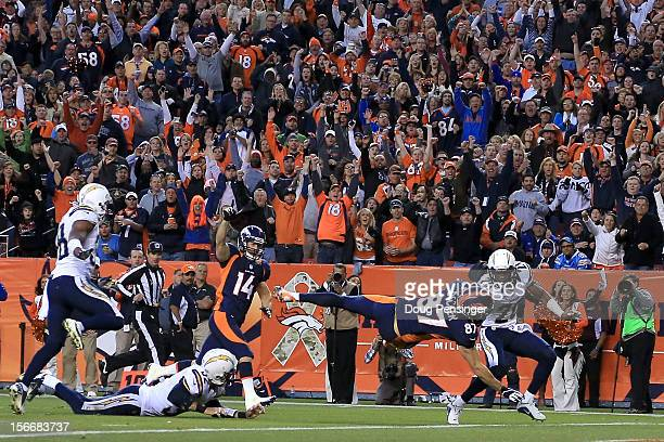 Wide receiver Eric Decker of the Denver Broncos dives into the endzone for a 20 yard touchdown reception against the San Diego Chargers in the third...