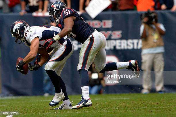Wide receiver Eric Decker of the Denver Broncos makes a circus catch in front of inside linebacker Darryl Sharpton of the Houston Texans for 6 yards...