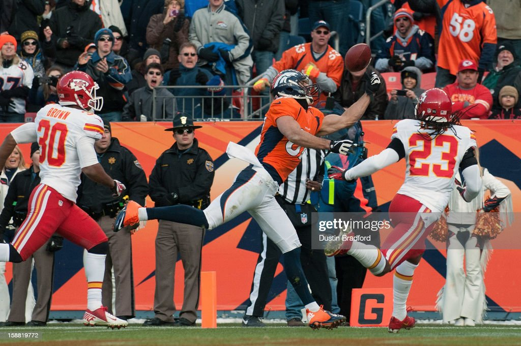 Wide receiver Eric Decker #87 of the Denver Broncos makes a touchdown catch in the closing seconds of the first half of a game against the Kansas City Chiefs at Sports Authority Field Field at Mile High on December 30, 2012 in Denver, Colorado.
