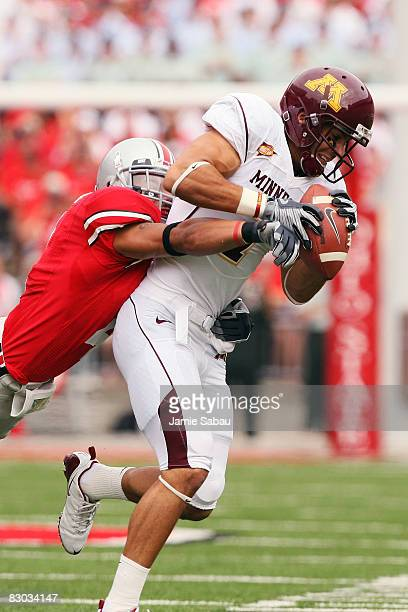 Wide receiver Eric Decker of the Minnesota Golden Gophers holds onto a pass reception as Kurt Coleman of the Ohio State Buckeyes makes the tackle on...