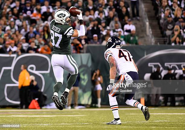 Wide receiver Eric Decker of the New York Jets makes a catch as free safety Chris Conte of the Chicago Bears defends during a game at MetLife Stadium...