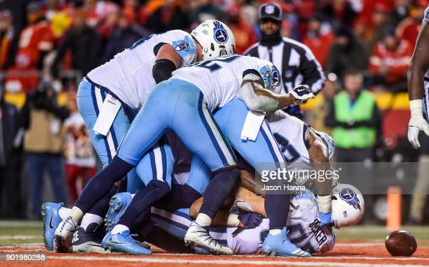 Wide receiver Eric Decker of the Tennessee Titans is dog piled by teammates after scoring the go ahead touchdown against the Kansas City Chiefs...