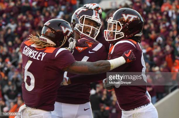 Wide receiver Eric Kumah of the Virginia Tech Hokies celebrates his touchdown reception against the Boston College Eagles with teammates wide...