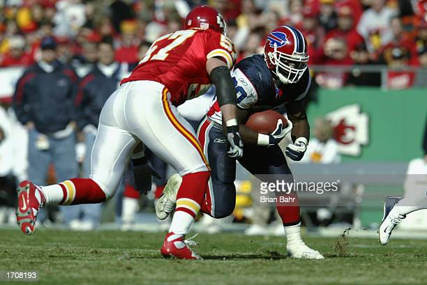 Wide Receiver Eric Moulds of the Buffalo Bills runs against Outside Linebacker Mike Maslowski of the Kansas City Chiefs during the NFL game at...