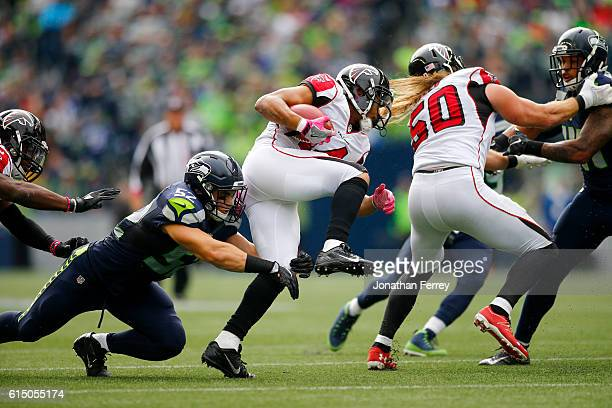 Wide receiver Eric Weems of the Atlanta Falcons tries to break free from linebacker Brock Coyle of the Seattle Seahawks at CenturyLink Field on...
