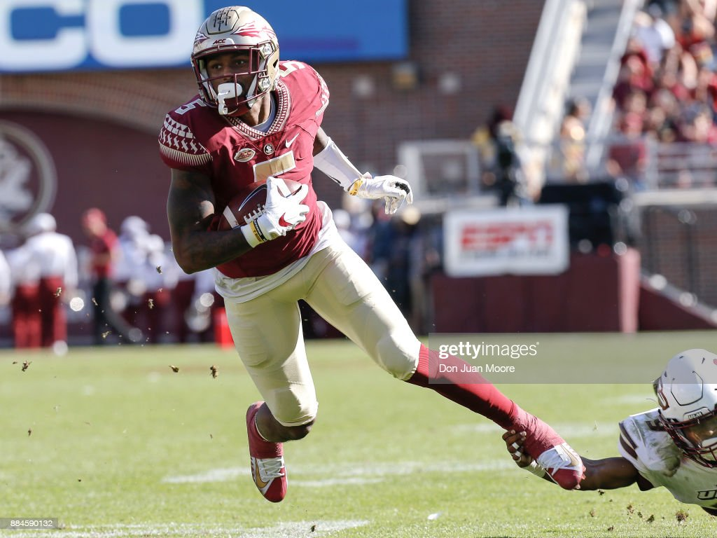 Wide Receiver Ermon Lane #5 of the Florida State Seminoles is shoe stringed tackled by Cornerback Marcus Hubbard #9 of the Louisiana Monroe Warhawks at Doak Campbell Stadium on Bobby Bowden Field on December 2, 2017 in Tallahassee, Florida. Florida State defeated Louisiana Monroe 42 to 10.