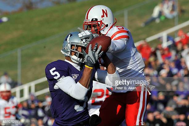 Wide receiver Ernie Pierce of the Kansas State Wildcats catches a 63yard touchdown pass against defensive back Anthony West of the Nebraska...