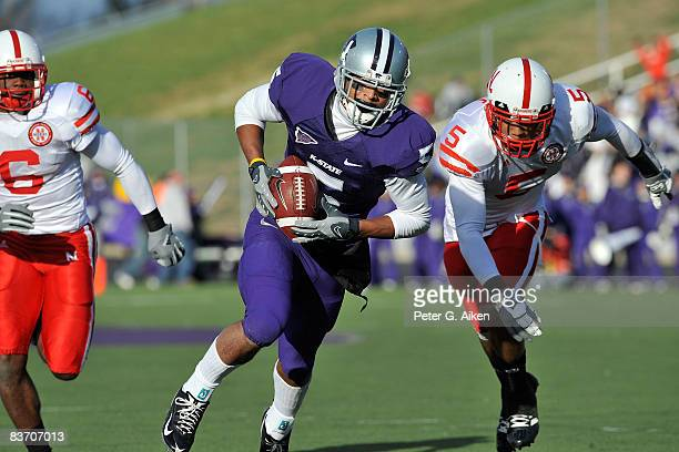 Wide receiver Ernie Pierce of the Kansas State Wildcats rushes up field past defensive back Anthony West of the Nebraska Cornhuskers enroute to a...