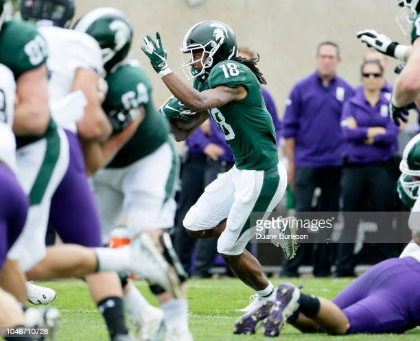 Wide receiver Felton Davis III of the Michigan State Spartans carries the ball against the Northwestern Wildcats during the first half at Spartan...