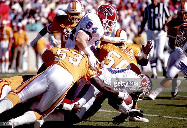 Wide Receiver Flip Johnson of the Buffalo Bills plows for yardage with the help of Defensive End Mark Pike after an interseption before being tackled...